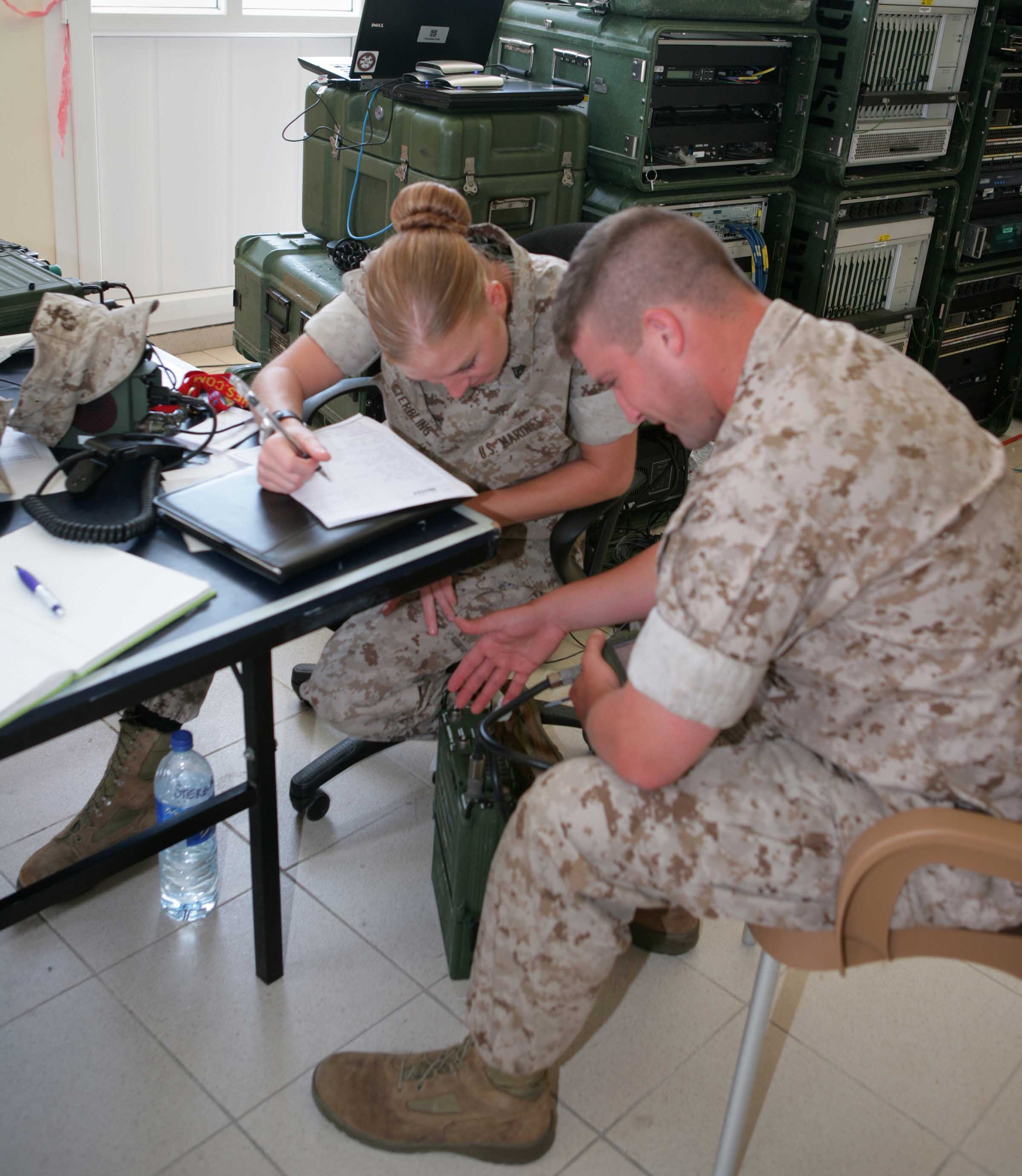 female marines in the media the semi normal day to day cpl erin sterbling a radio operator communications company headquarters battalion 4th marine division instructs lcpl travis white a field radio